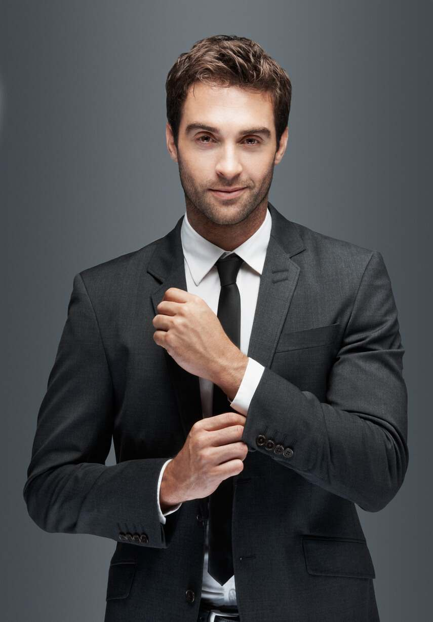 a flamboyant and handsome man in a dark grey men's suit image on richardsclothing.ca Premium fashion men's clothing store in London ON