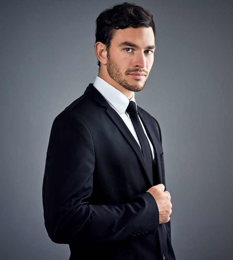 a flambouyant and handsome man in a dark grey men's suit image on richardsclothing.ca Premium fashion men's clothing store in London ON