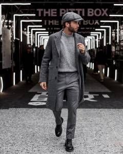 Portrait of man in a charcoal gray outerwear, stylish pants and pullover on richardsclothing.ca Premium fashion men's clothing store in London ON
